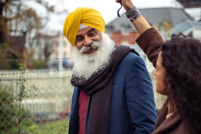Older Sikh man and younger woman