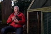 Older man with chicken