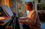 Older woman playing piano