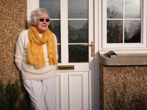 Woman outside house